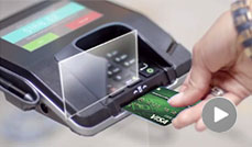 Person using a chip debit card in a chip card reader